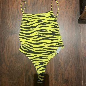Neon yellow and black body suit